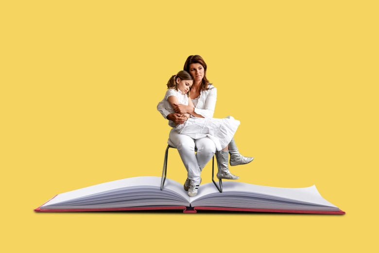 A woman sits on a chair and holds her daughter. The chair is on an open book.