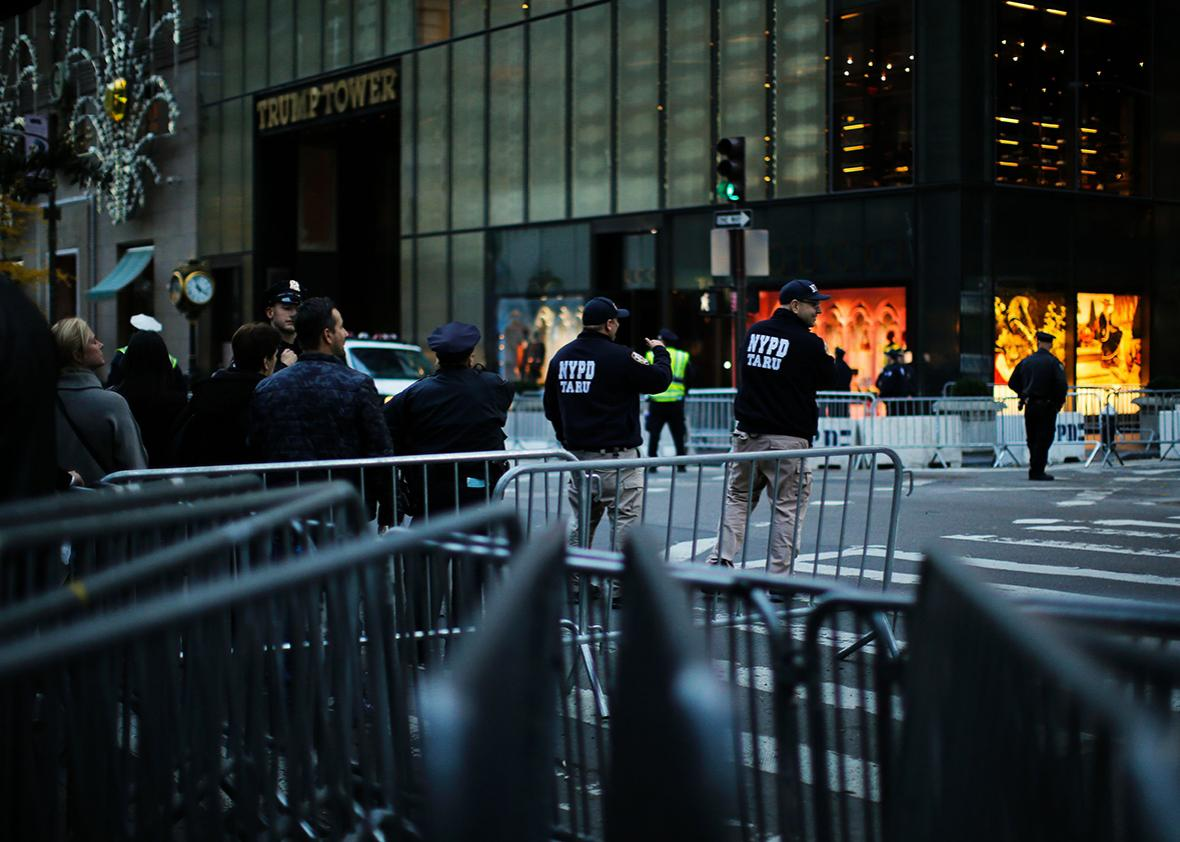 People walk through 5th Avenue near Trump Tower after the street was closed to foot traffic by police with barricades and officers at the entrance to the block at both ends for more than two weeks in New York on November 18, 2016.