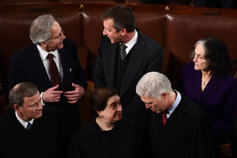 Kagan speaks to Gorsuch as Roberts looks on