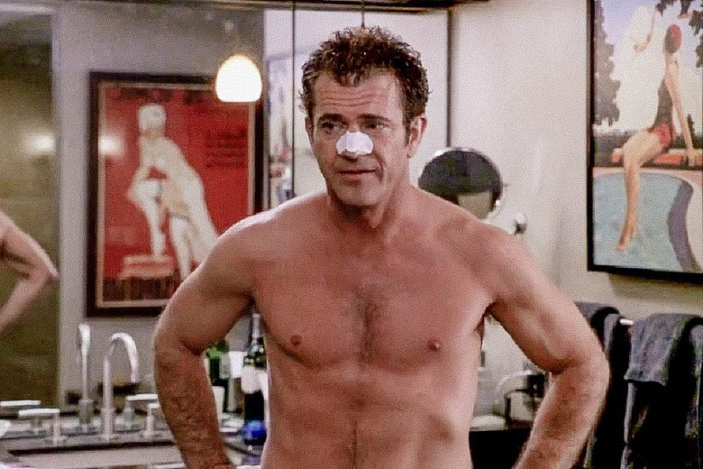 Mel Gibson in What Women Want.  Still from What Women Want where Mel Gibson is seen shirtless, from the torso up, in a bathroom, wearing a pore strip on his nose.