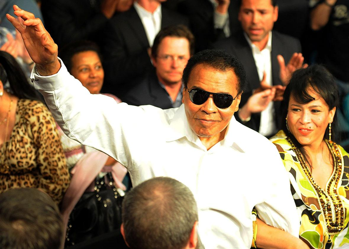 Muhammad Ali salutes the crowd before the 2010 Floyd Mayweather Jr. and Shane Mosley welterweight fight in Las Vegas.
