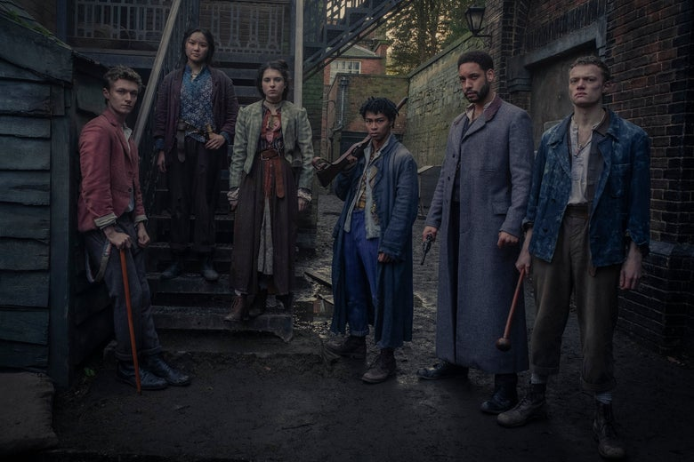 A racially diverse group of young men and women on the streets of late Victorian-era London. Many of them carry weapons. They look not wealthy, but stylish.