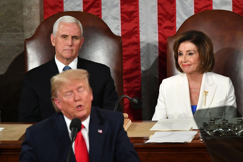 Mike Pence and Nancy Pelosi seated behind Donald Trump as he delivers the State of the Union address.
