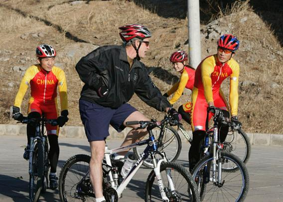 George W. Bush riding a bicycle in China, 2005