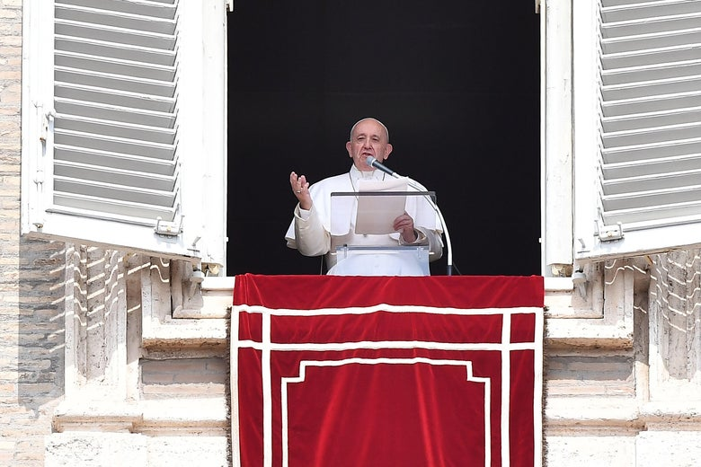 Pope Francis speaks from the window of the apostolic palace after being freed from his elevator.