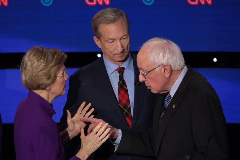 Elizabeth Warren and Bernie Sanders face each other in a heated conversation onstage as Tom Steyer looks on beside them.