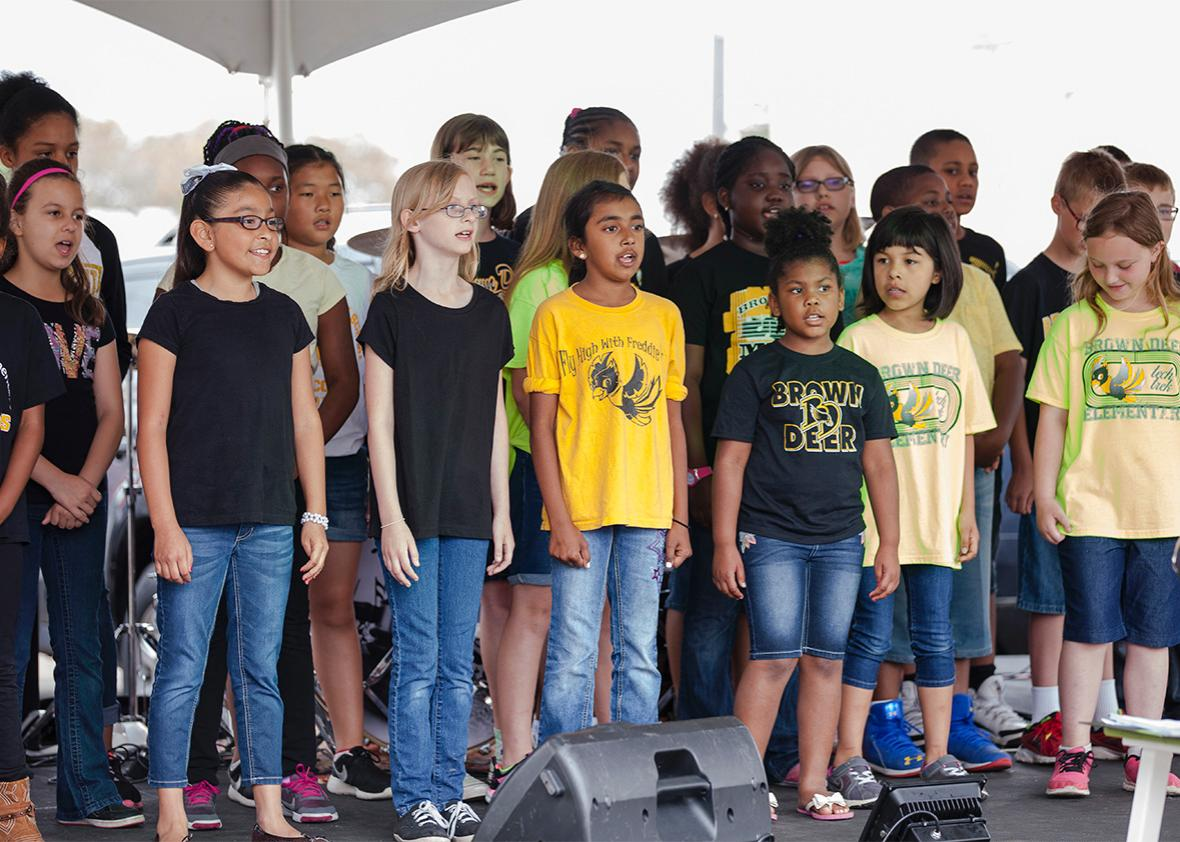 "The elementary school choir performs on stage at The Village of ,The elementary school choir performs on stage at The Village of Brown Deer ""Eat & Greet on the Street"" festival on Saturday June 4, 2016."