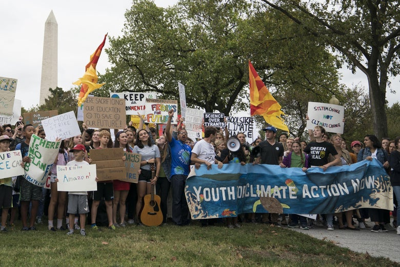 Student environmental advocates participate in a strike to demand that action be taken on climate change outside the White House.