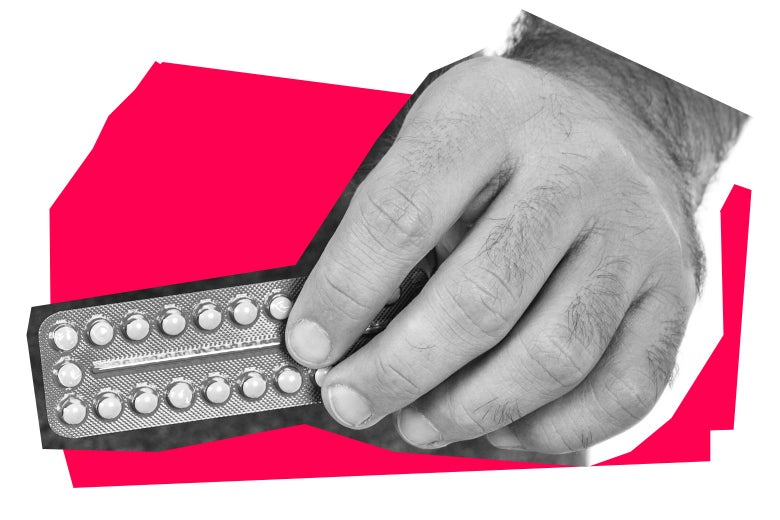 Hand holding a pack of birth control pills