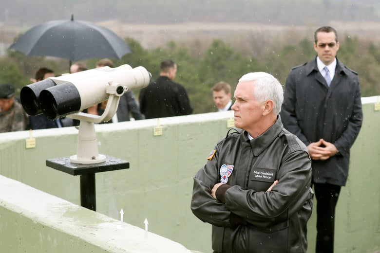 Pence, wearing a leather jacket, folds his arms and stares into the distance from atop what appears to be a military command post.