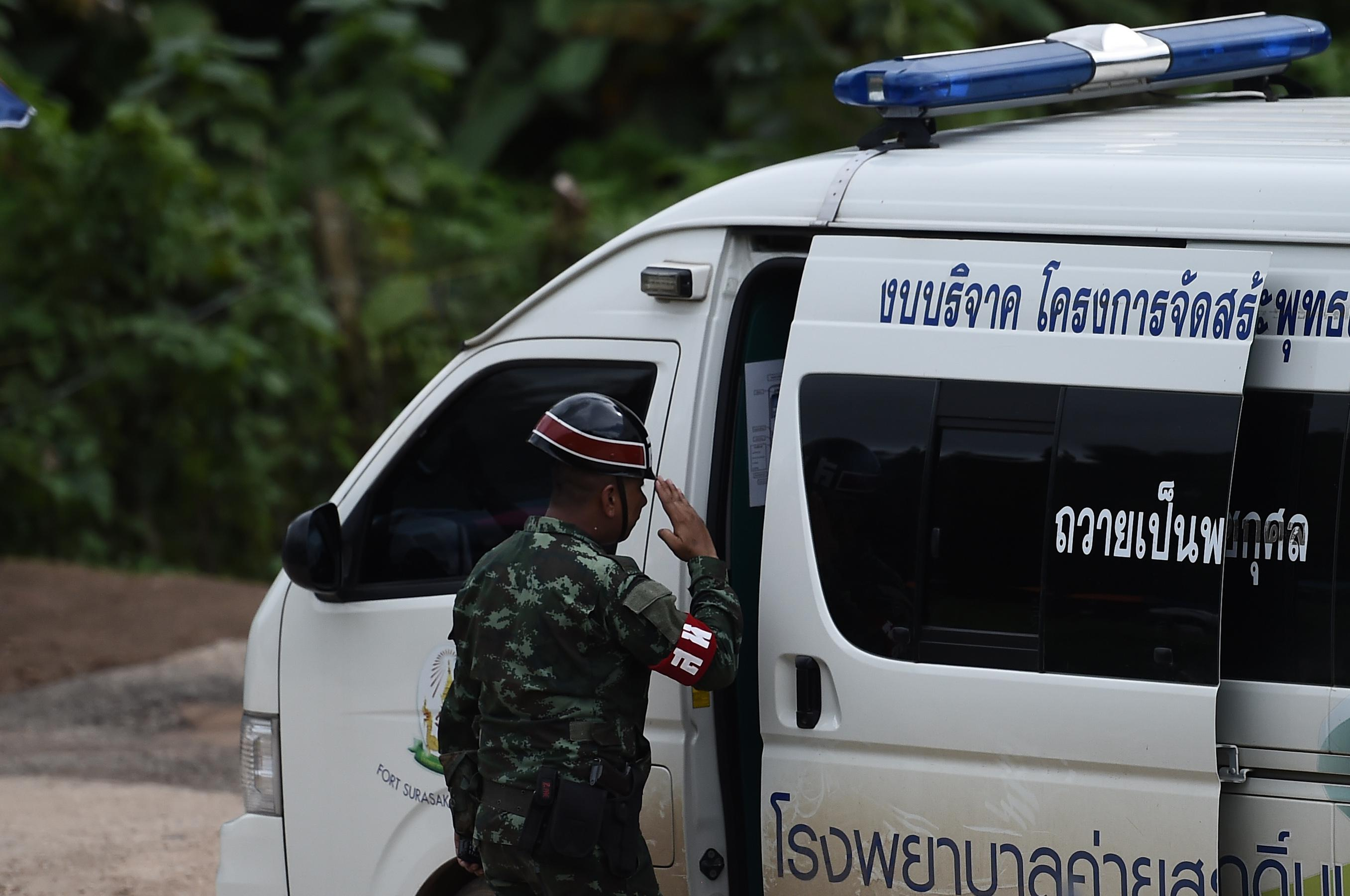 A Thai military police officer salutes an ambulance