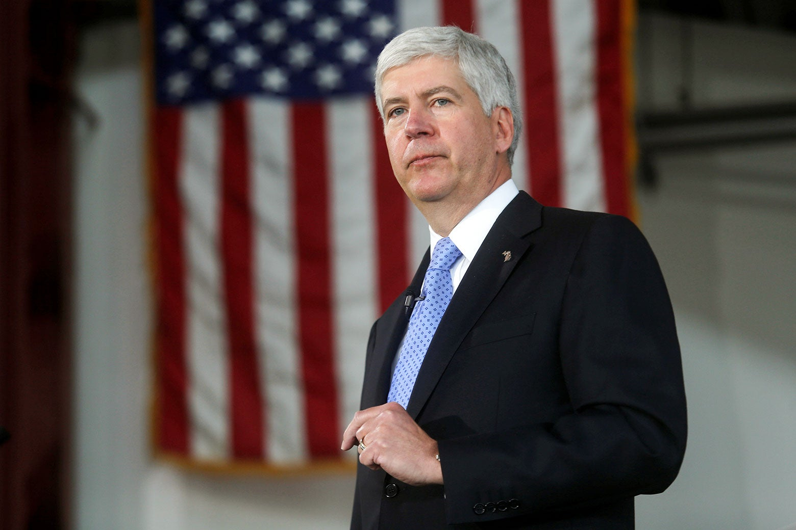Rick Snyder, with an American flag in the background.