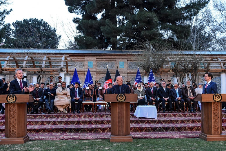 NATO Secretary General Jens Stoltenberg (L) speaks as Afghanistan's President Ashraf Ghani (C) and U.S. Secretary of Defense Mark Esper listen during a press conference at the presidential palace in Kabul on February 29, 2020.