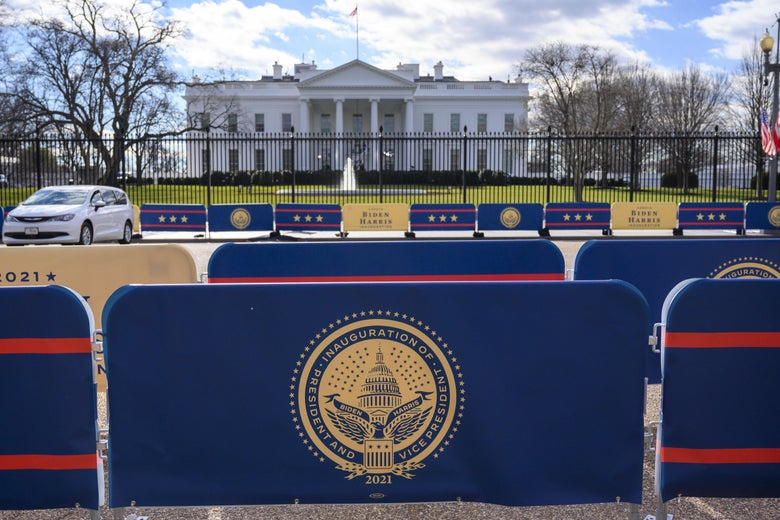 Banners and barriers are seen in front of the White House.
