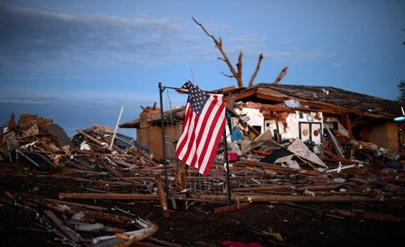 A U.S. flag is seen amongst the debris of a torando devastated house on May 21, 2013 in Moore, Oklahoma.