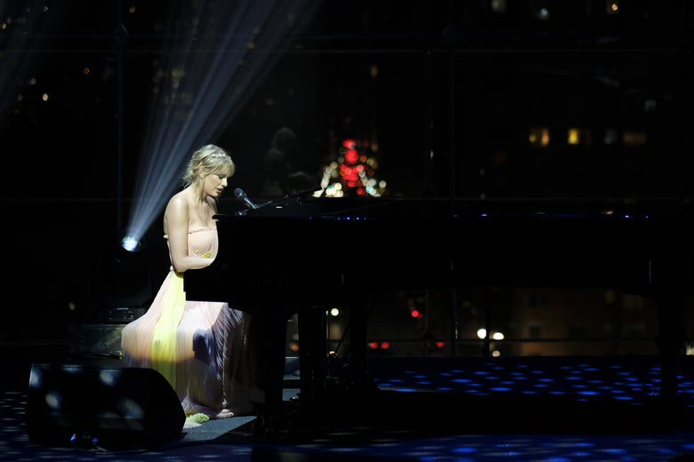 Taylor Swift singing and playing piano onstage at the TIME 100 Gala at Jazz at Lincoln Center in New York City on April 23.