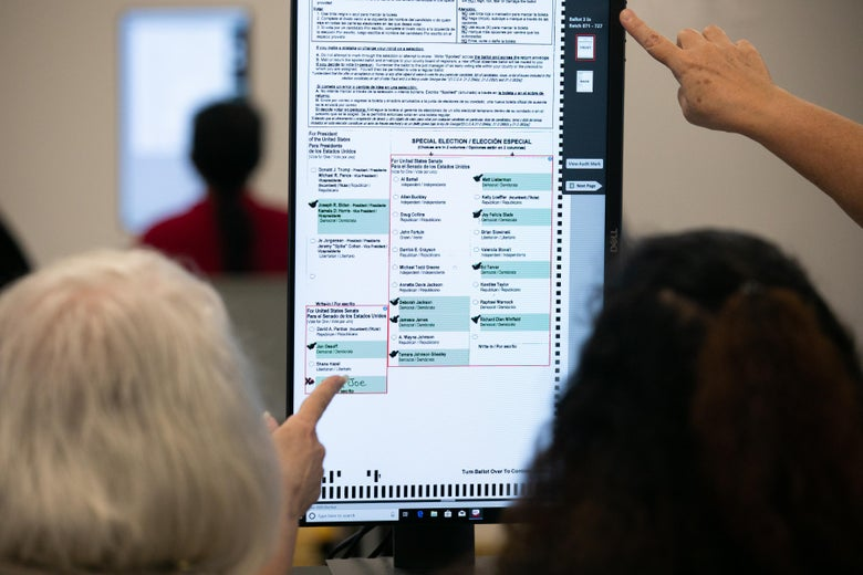 Members of the Gwinnett County adjudication review panel look over remaining scanned ballots.