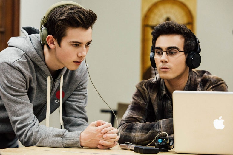 In a scene from American Vandal Season 2, Sam and Peter listen to a recording through their headphones.
