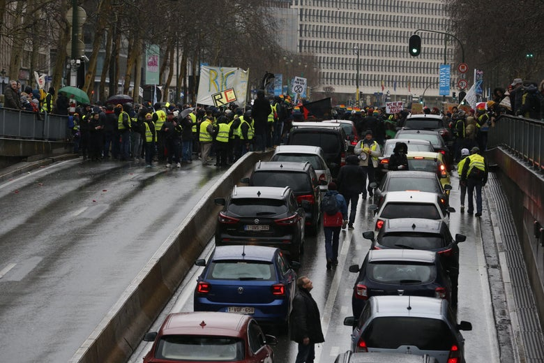 A traffic jam takes place outside a climate change awareness demonstration in Brussels.