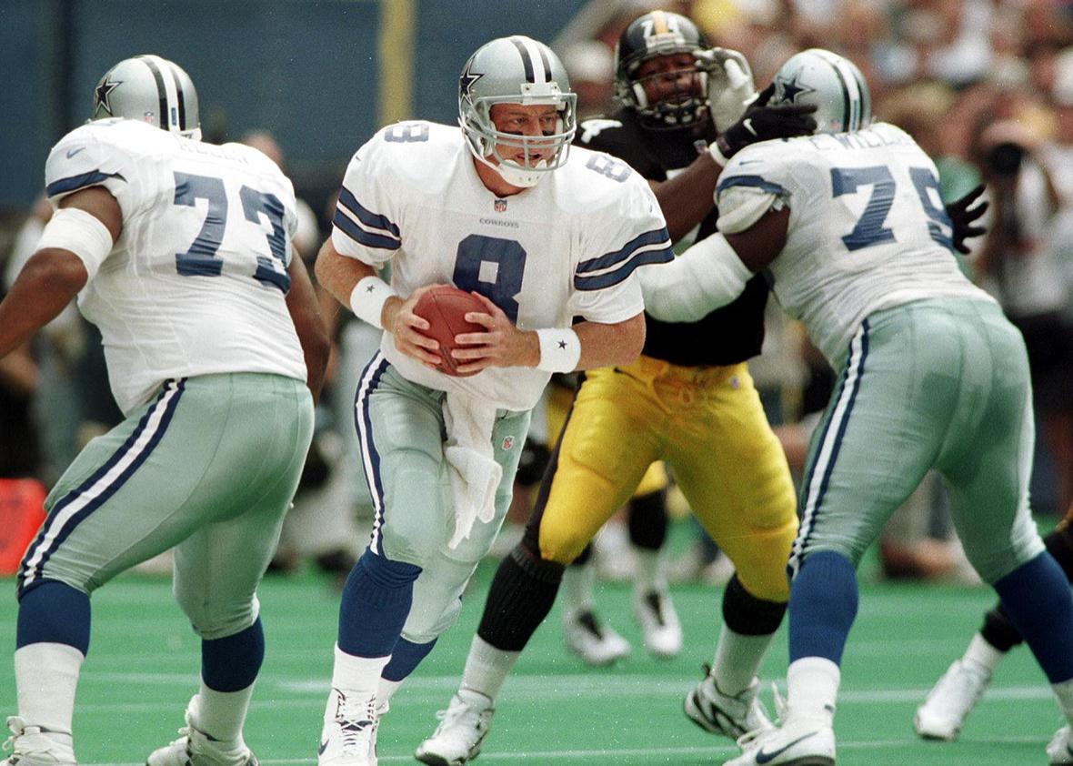 drops behind the line as he prepares to hand off the ball in the first half of their game against the Pittsburgh Steelers Aug. 31, 1997 at Three Rivers Stadium in Pittsburgh, PA.