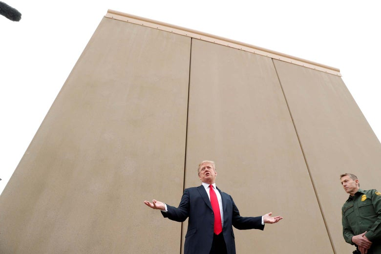 President Donald Trump speaks while participating in a tour of U.S.-Mexico border-wall prototypes.