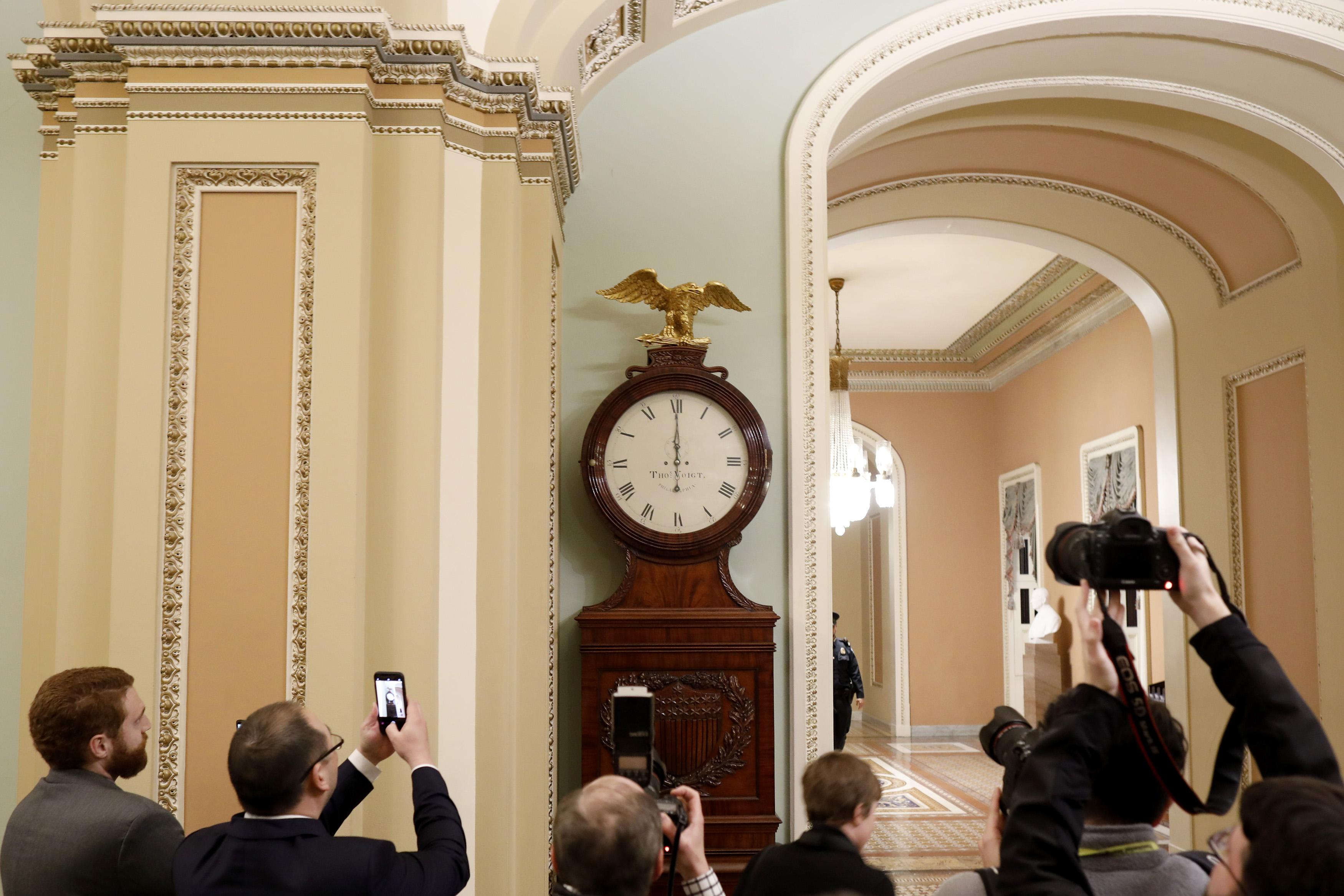 The Ohio Clock outside the Senate Chamber strikes midnight at the U.S. Capitol January 20, 2018 in Washington, DC. Lawmakers were unable to pass a continuing resolution in time to avert a government shutdown.