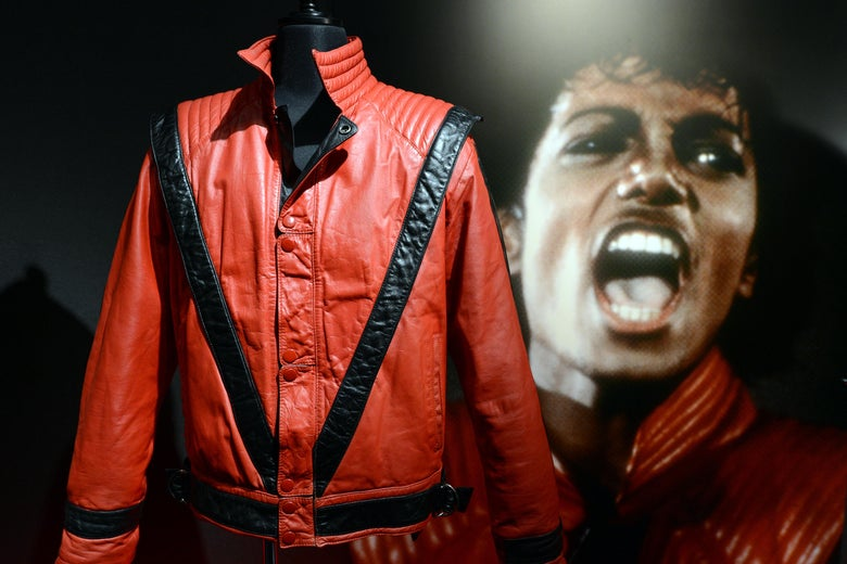 "Michael Jackson's ""Thriller"" style jacket is displayed next to a picture of him."
