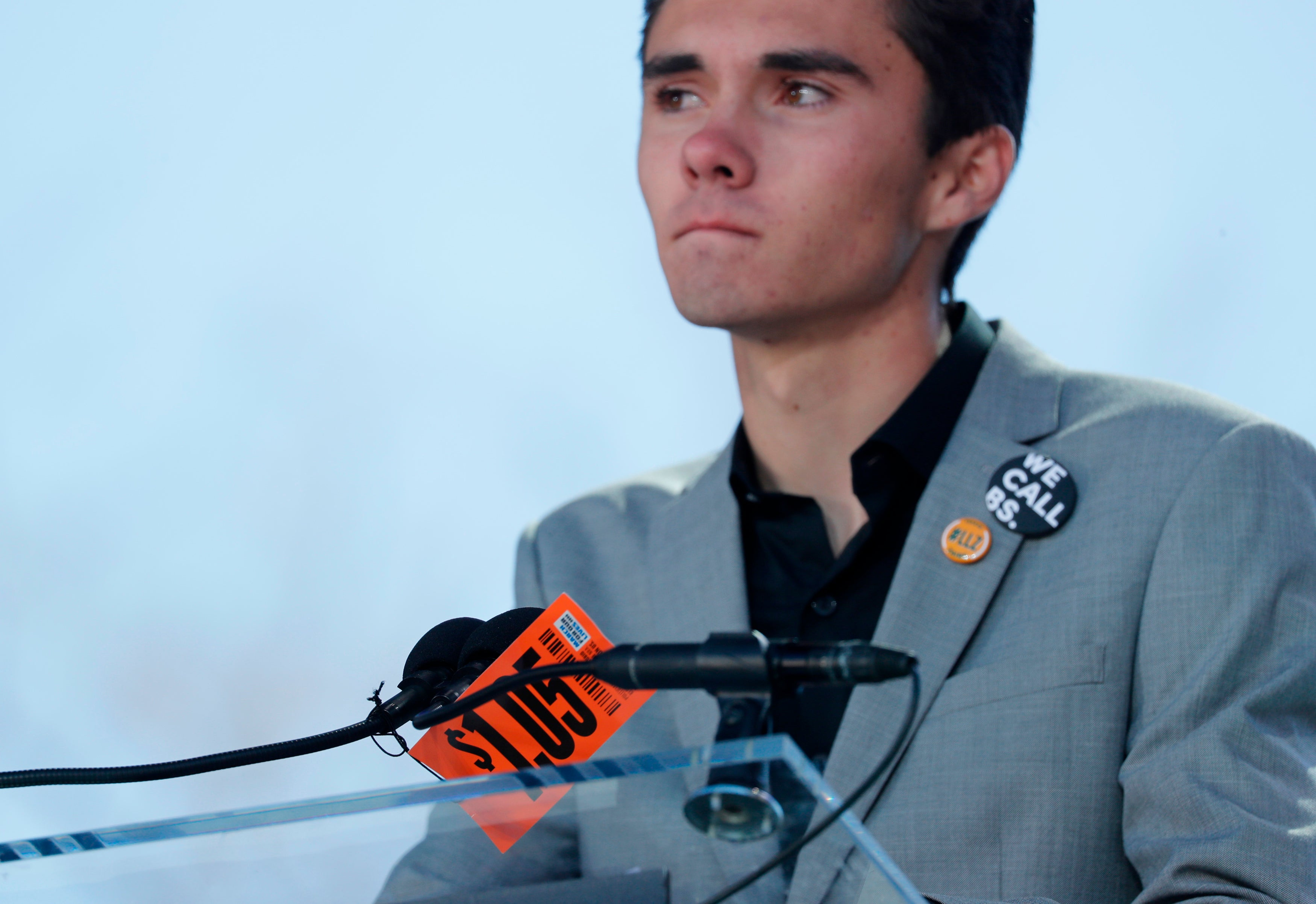 David Hogg, a student at the Marjory Stoneman Douglas High School, speaks with a $1.05 tag in front of him at the March for Our Lives rally in Washington, D.C. on March 24, 2018.