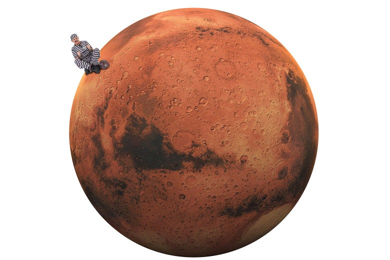A person in prison clothes sitting on Mars.