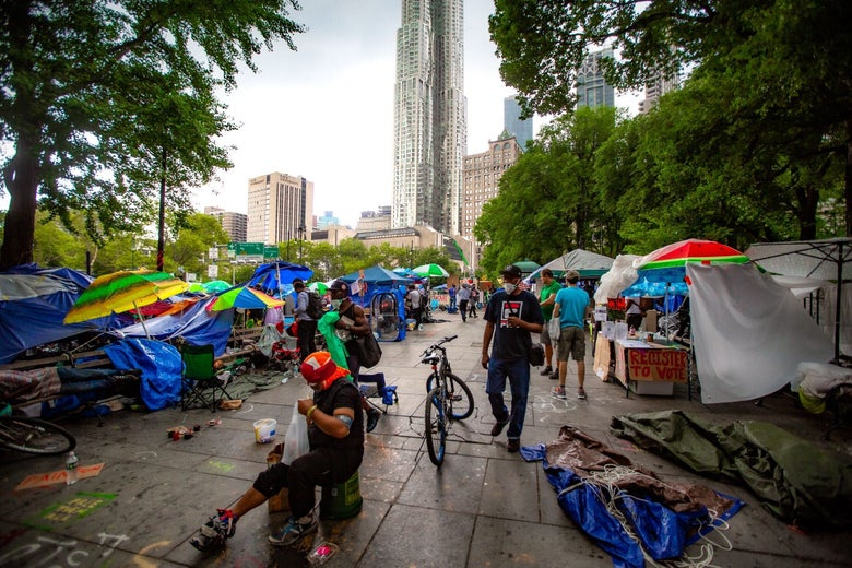 Tents and protesters at Occupy City Hall, with City Hall in the background