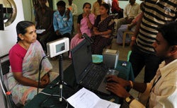 An Indian villager looks at an Iris scanner during the data collecting process.