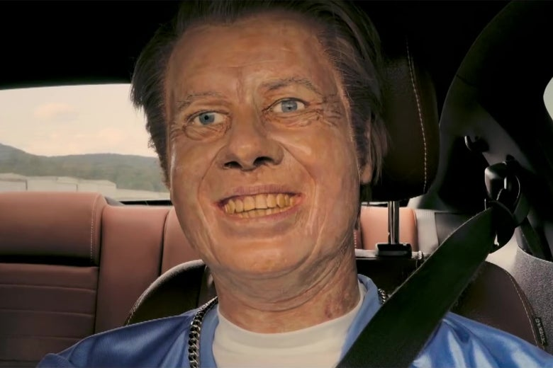 A bad wax statue of Jimmy Carter, posed to look like he's driving a car.