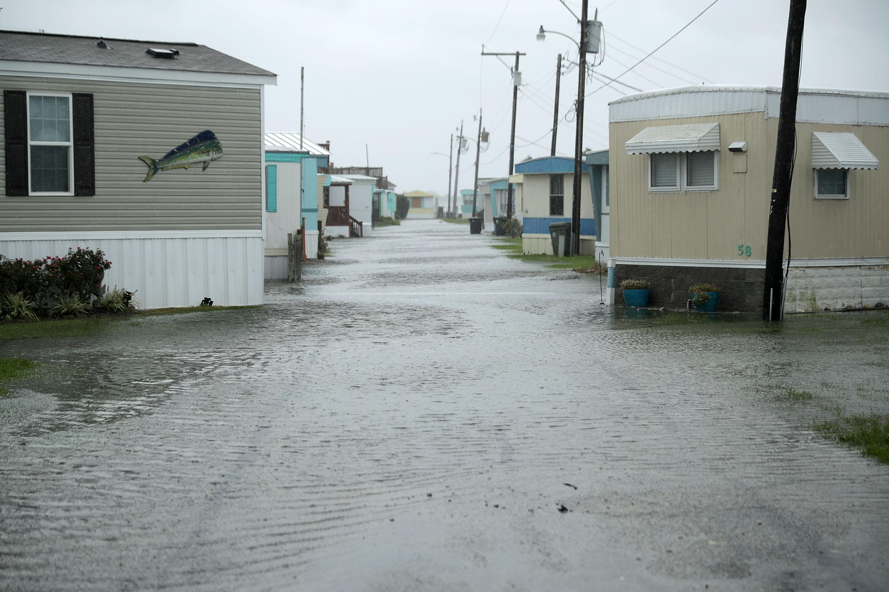 Flash flooding covers the road in low-lying areas in Atlantic Beach, N.C., as the outer edges of Hurricane Florence begin to affect the coast on Thursday.
