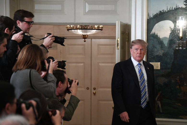 President Donald Trump arrives to speak on the Florida school shooting, in the Diplomatic Reception Room of the White House on February 15, 2018 in Washington, D.C.