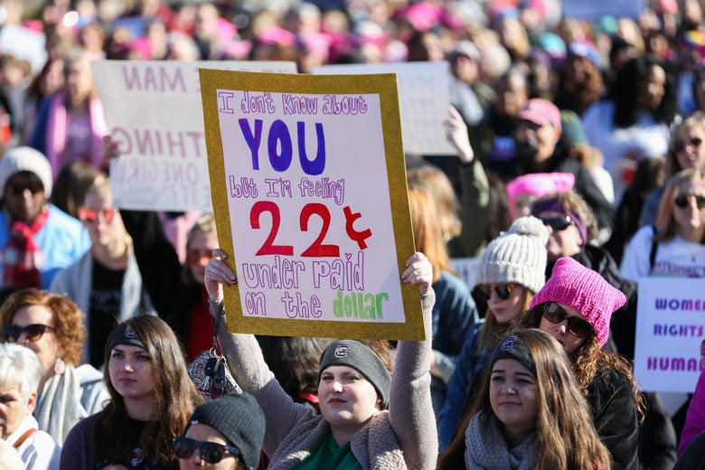A woman holds a sign in First Ward Park as she takes part in the Remarchable Women rally in Charlotte, North Carolina on January 20, 2018, marking the one-year anniversary of the Women's March.