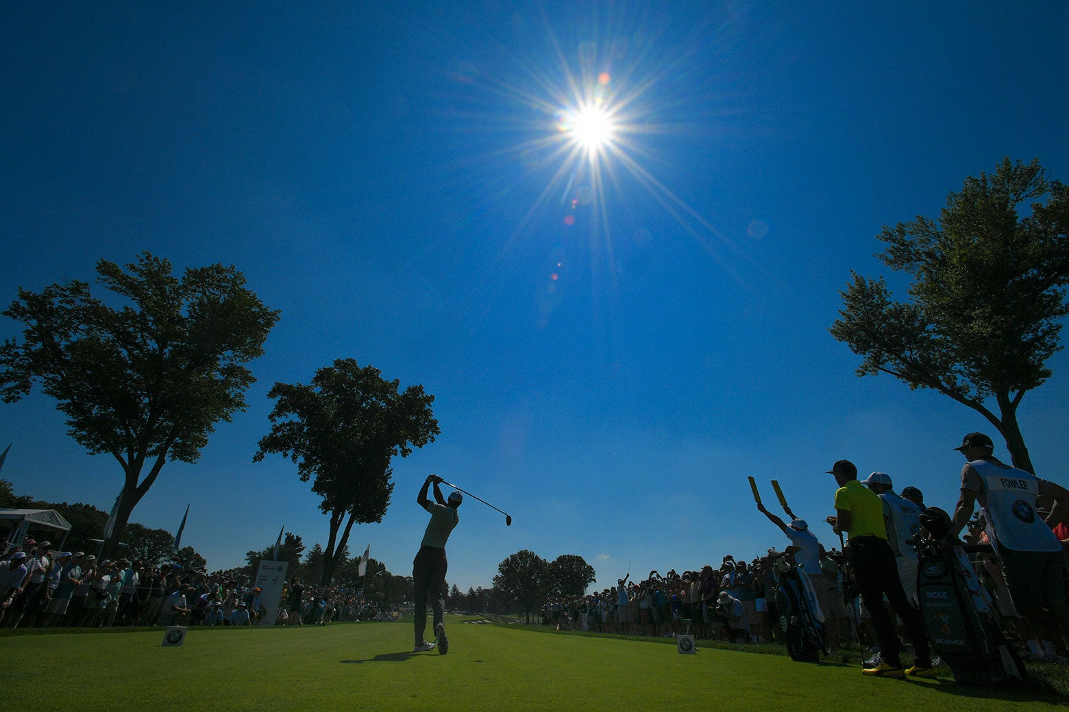 Tiger Woods plays a tee shot on the 11th hole during the first round of the BMW Championship/