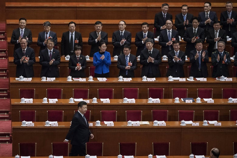 China's President Xi Jinping is applauded as he arrives to a session of the National People's Congress to vote on a constitutional amendment at The Great Hall Of The People on March 11, 2018 in Beijing, China.
