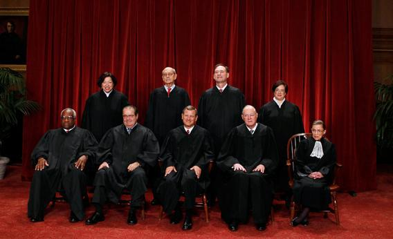 The justices of the U.S. Supreme Court gather for a group portrait in the East Conference Room at the Supreme Court Building in Washington, October 8, 2010.