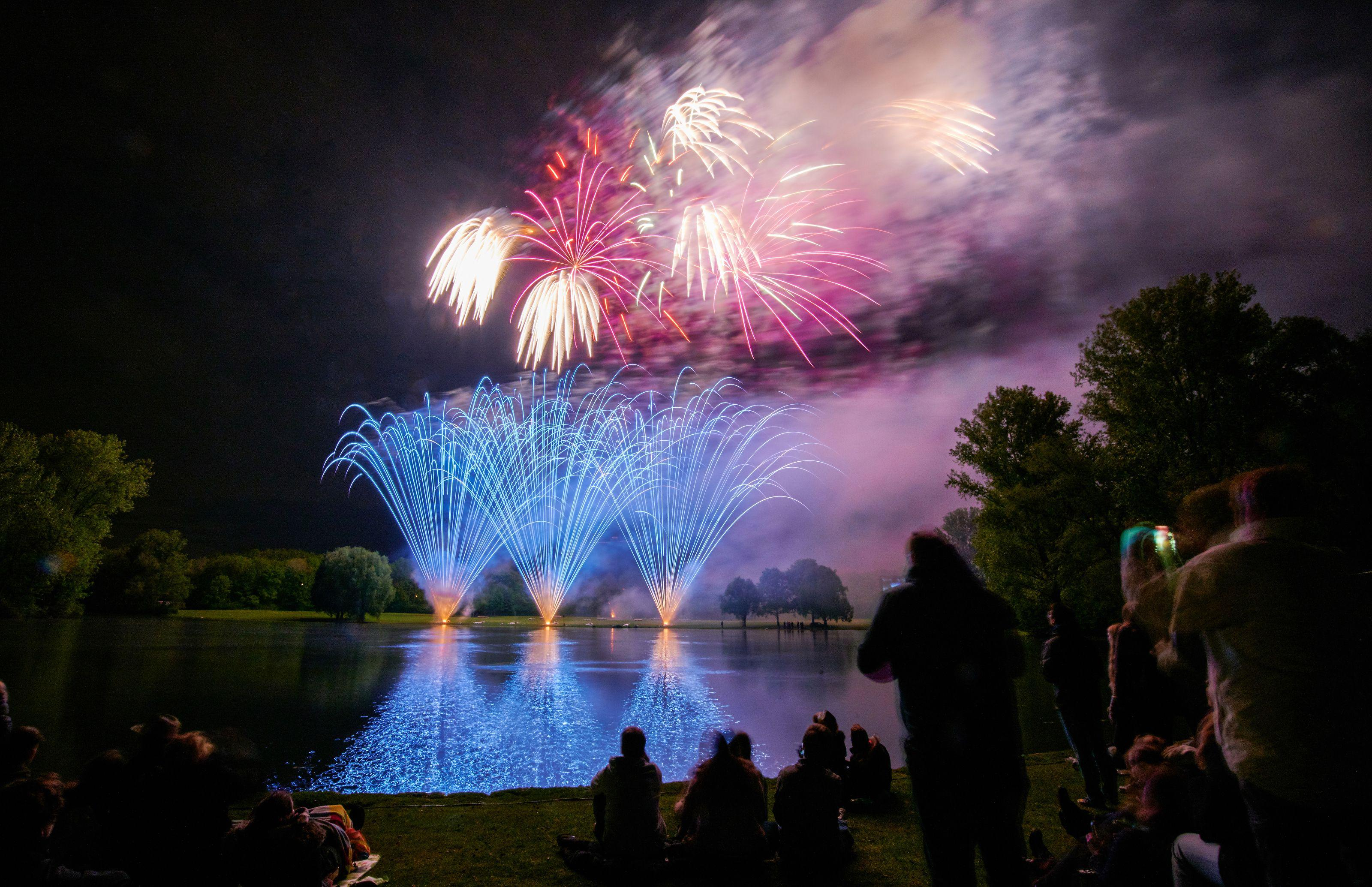 """People watch fireworks fired along the River Rhine during the annual """"Rhine in flames"""" festival on May 5, 2019 in Bonn. (Photo by Volker Lannert / dpa / AFP) / Germany OUT        (Photo credit should read VOLKER LANNERT/AFP/Getty Images)"""