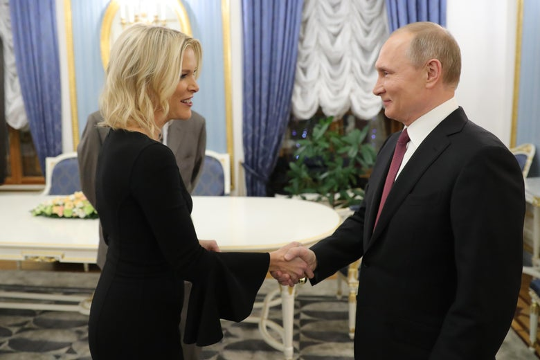 Russia's President Vladimir Putin (R) shakes hands with US NBC news network anchor Megyn Kelly prior to an interview at the Kremlin on March 1, 2018 in Moscow. / AFP PHOTO / SPUTNIK / Michael Klimentyev        (Photo credit should read MICHAEL KLIMENTYEV/AFP/Getty Images)