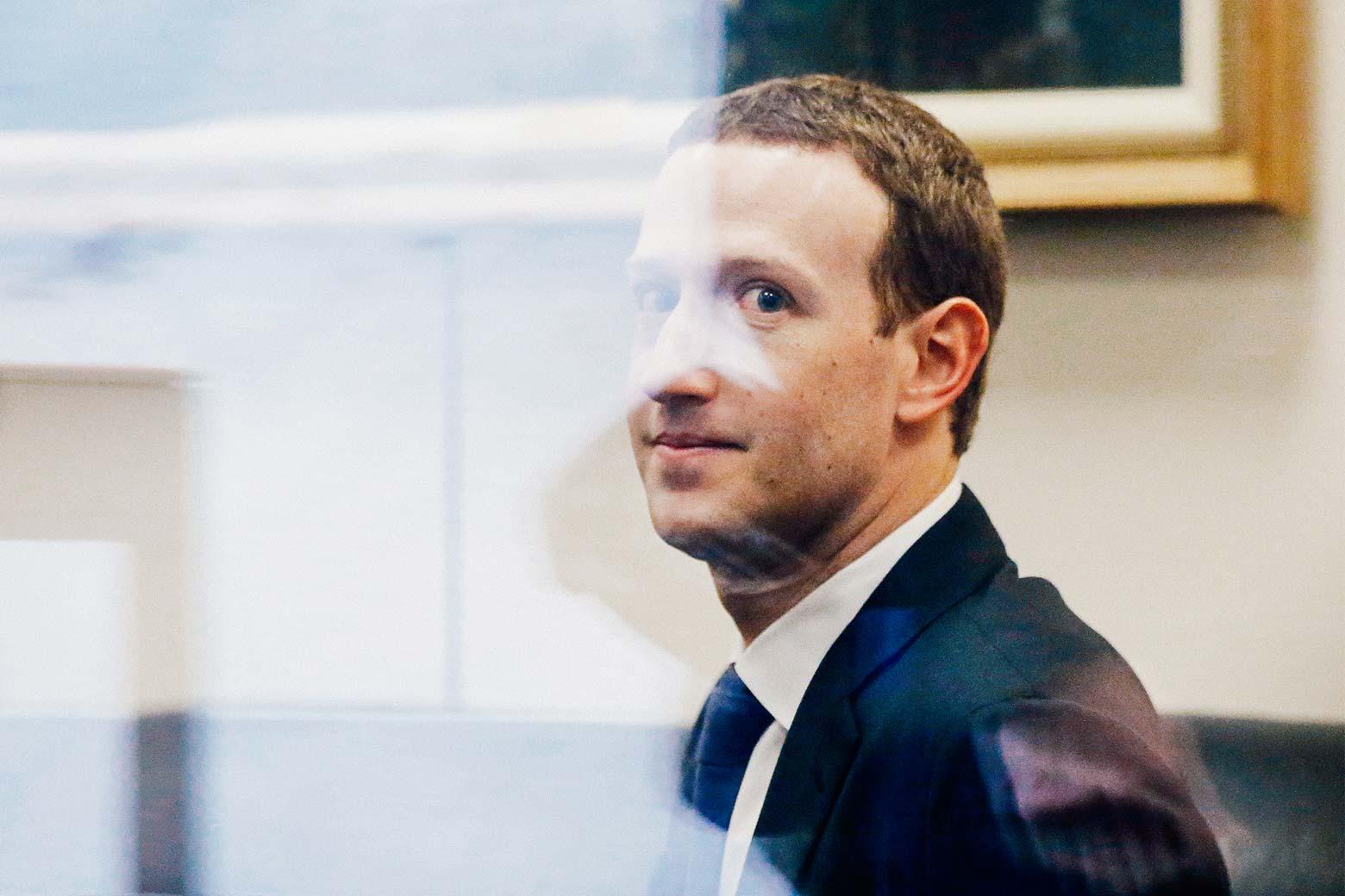 Facebook CEO Mark Zuckerberg sits in the office of Florida Sen. Bill Nelson on Monday in Washington.