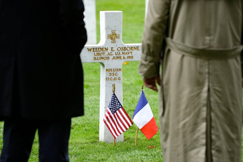 People pay respect at a tomb at the Aisne-Marne American Cemetery and Memorial in Belleau, on November 10, 2018.