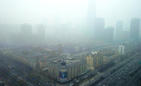 Skyscrapers are obscured by heavy haze in Beijing Sunday, Jan. 13, 2013.