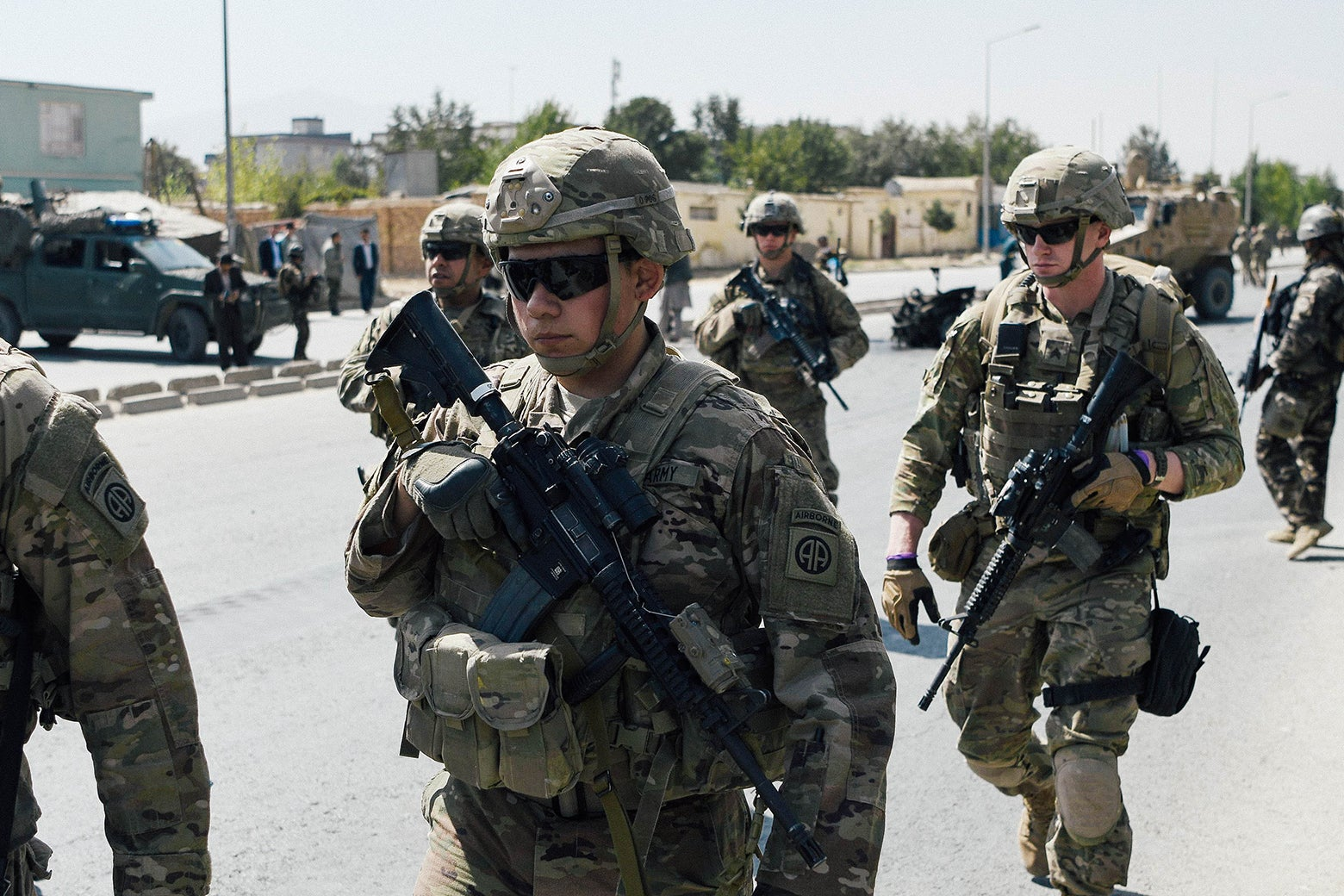 U.S. soldiers walk down a road in Kabul.