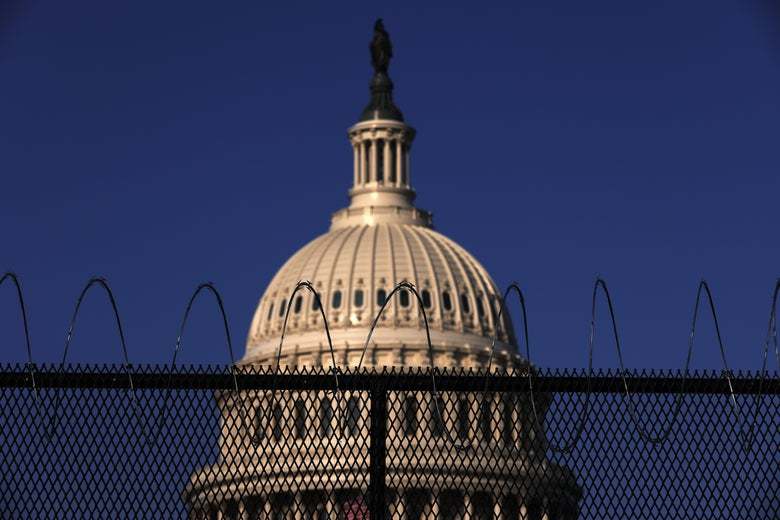 Razor wire is seen on the top of fencing that surrounds the Capitol.