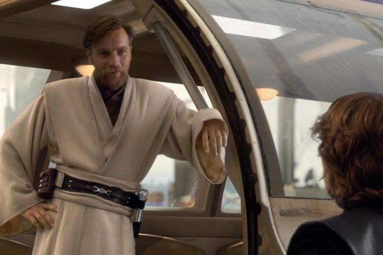 Ewan McGregor, as Obi-Wan Kenobi, leans against the doorway of a starship.