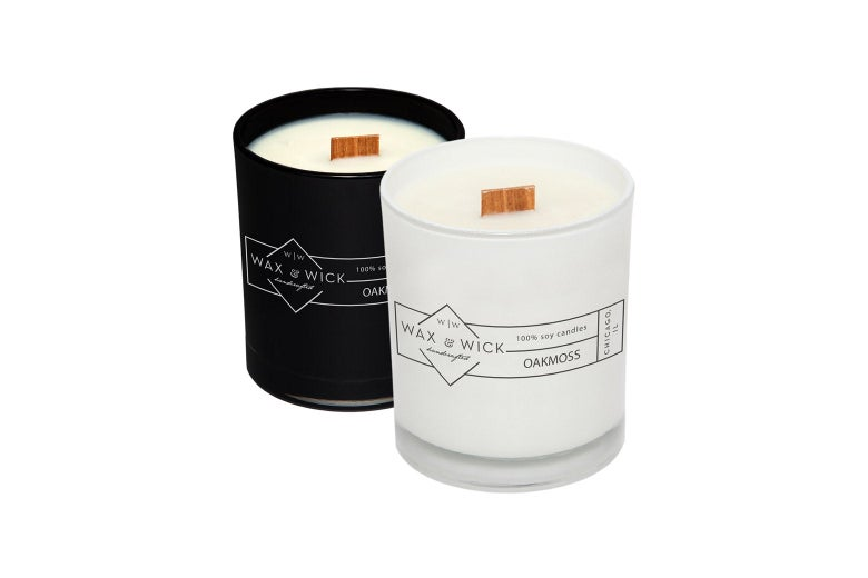 Two Wax and Wick candles, one in a black jar, one in a white jar.
