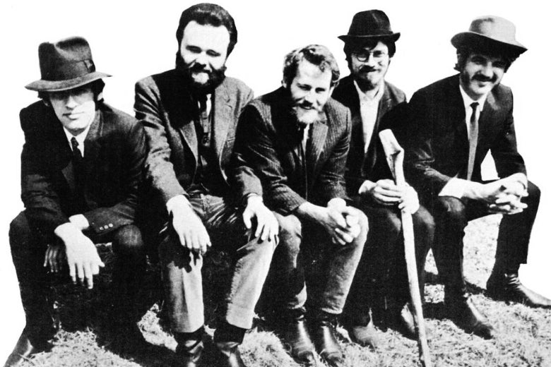 Black-and-white photo of the Band in old-timey clothes