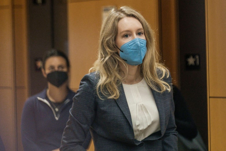 a blonde woman in a blue mask