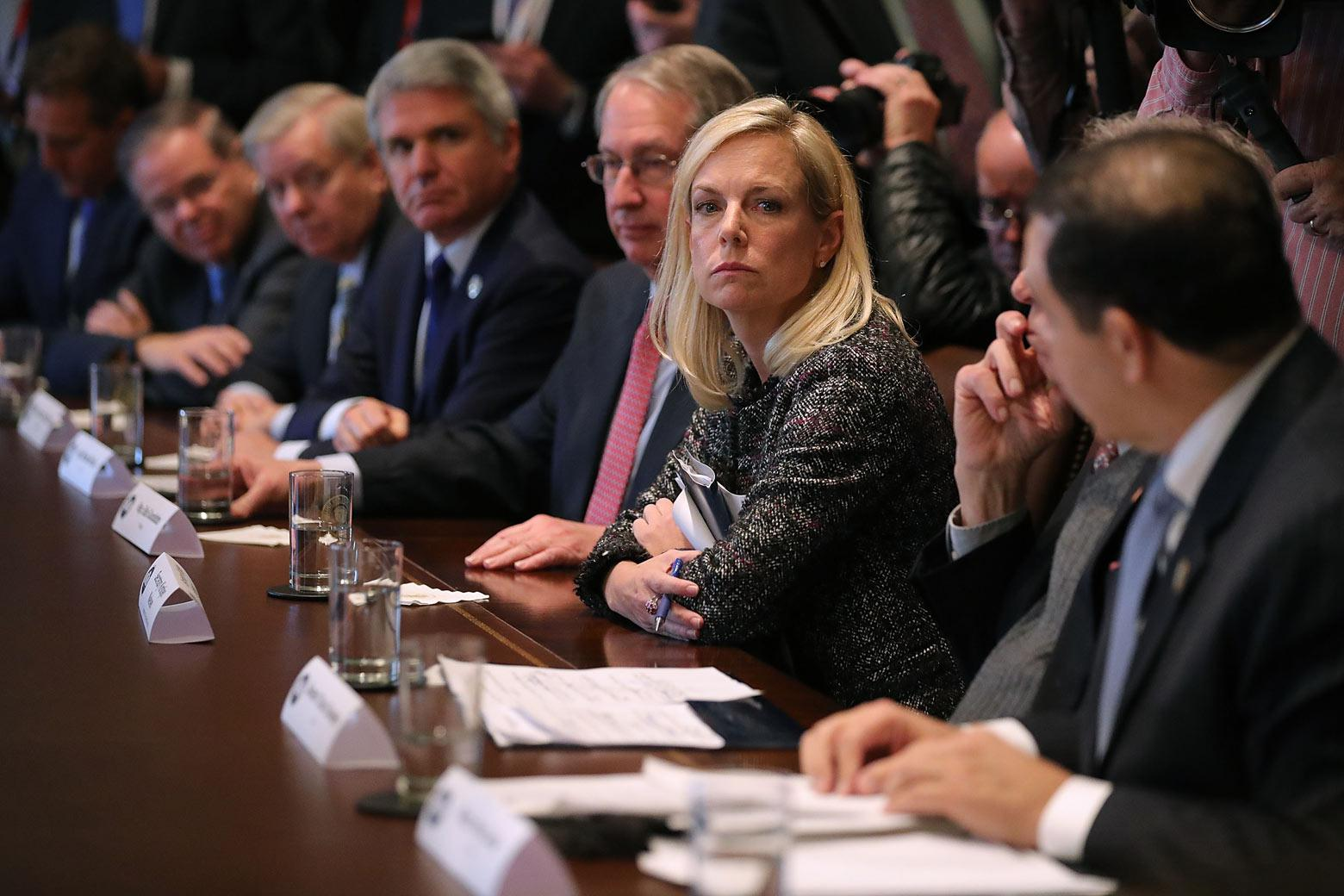 Homeland Security Secretary Kristjen Nielsen joins President Donald Trump and Republican and Democrat members of Congress for a meeting on immigration on Tuesday in Washington.